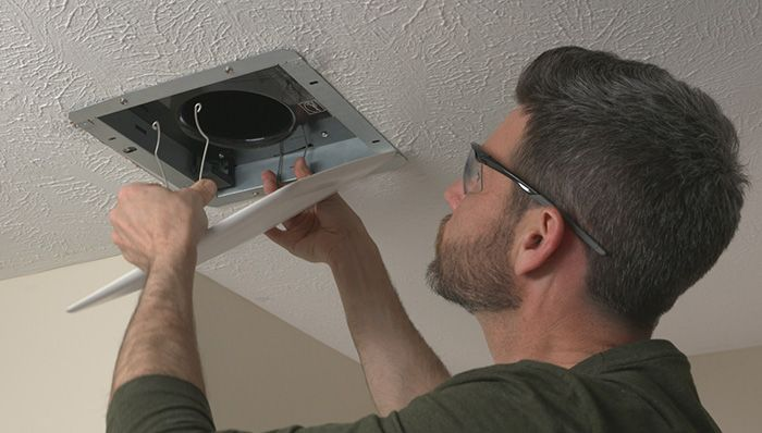 What is the cost of hiring a professional to fix your ventilation fan in the bathroom?